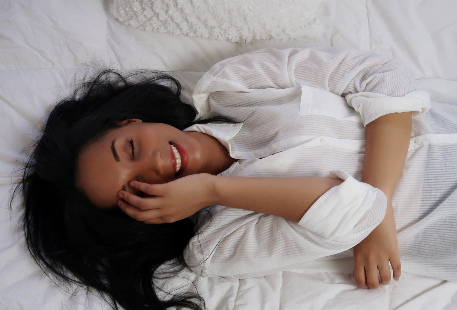 Wonan laughing on bed